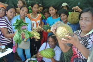 Women farmers of KNBL in Davao City proudly show off their organic and natural products.